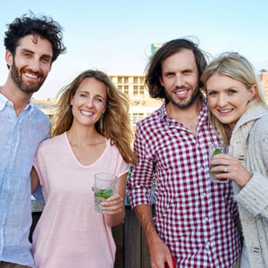 potrait of happy group of friends having fun with drink on outdoor rooftop terrace