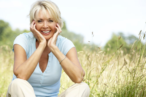 retired woman smiling in a field